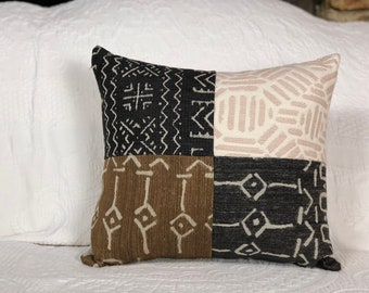 Patchwork cushion in luxe tribal upholstery pieces