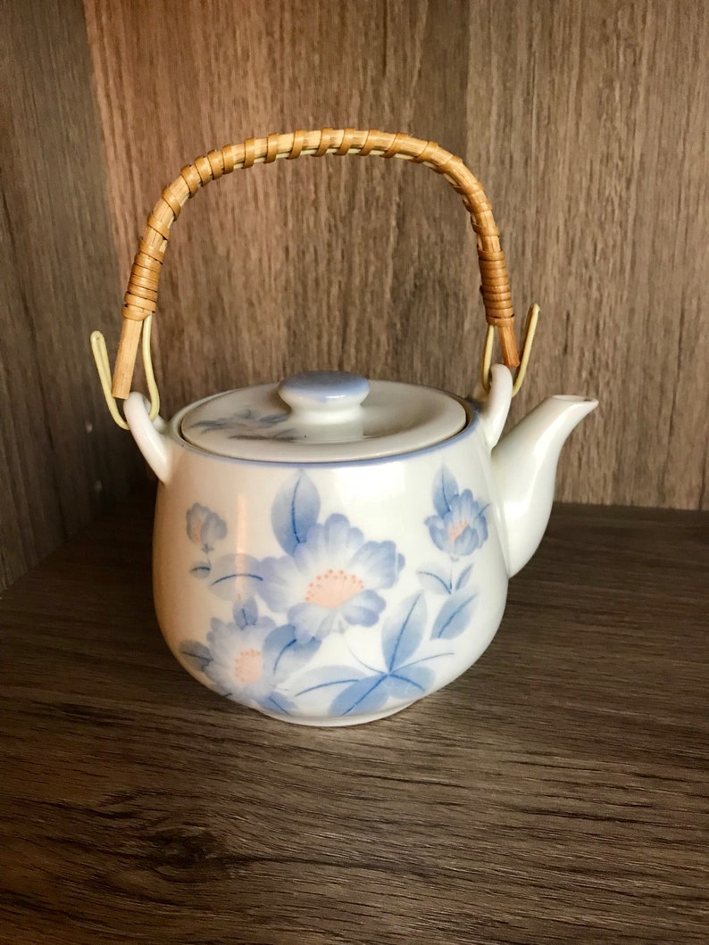 Blue flowersfloral design Vintage Asian White and Blue Teapot Ceramic Wrapped handle holds a little over 20 oz