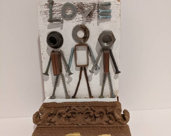 People plaques made from old vintage hardware and reclaimed wood