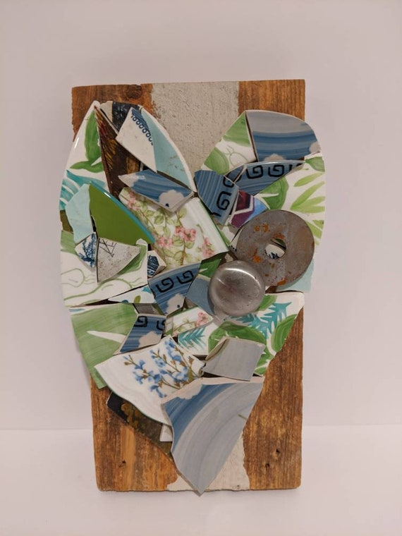 This broken pottery upcycled mosaic art is made from several different China patterns including greens blues Pink's and florals