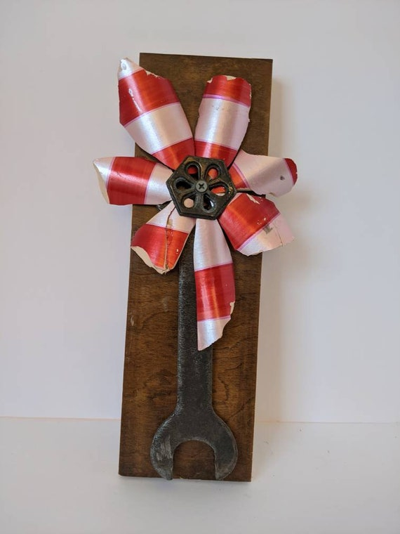 Broken turns beautiful with this lovely flower. Red and pink candy striped pottery has new life with vintage hardware center and wrench stem