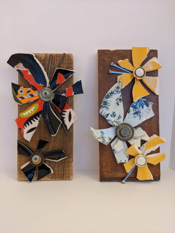 Broken and beautiful wall mounted flowers. Give her the flowers that never need water and will never die!
