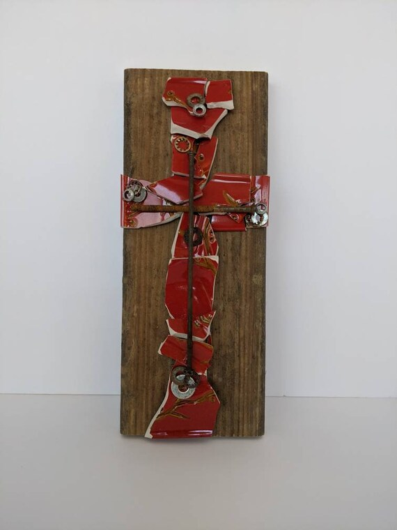 This broken & beautiful cross is made with red broken pottery and a variety of old rusty hardware. Together, everything is new...