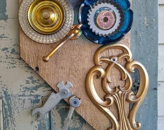 Upcycled, one of a kind mac-daddy wall hanging owl.