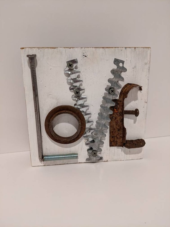 Free standing Love plaque made with upcycled nails & screws, vintage, rusty hardware mounted on white painted reclaimed wood