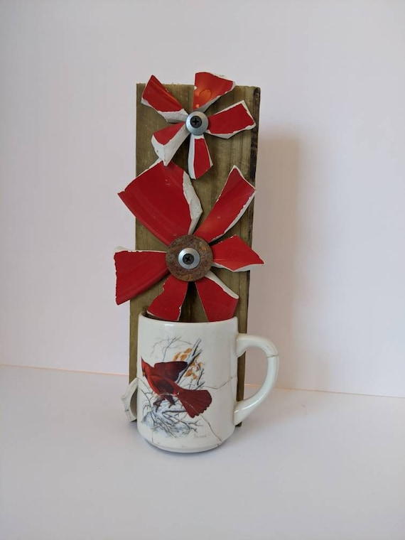 These Red broken and beautiful flowers in a cracked Cardinal coffee cup are a one-of-a kind free-standing addition to your home