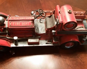 Red first  engine  with moving parts .