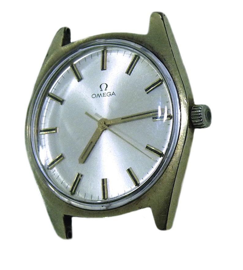 49ac0d087326 Vintage Omega Geneve Cal 601 mecánica oro plateado reloj