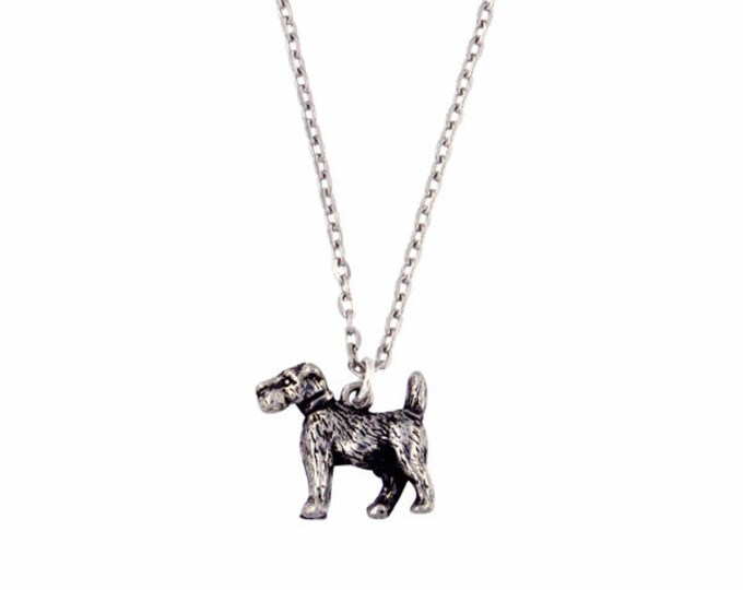 Dog Pendant – This affectionate and finely detailed Terrier sits on a rhodium plated 18″ trace train- Made and Design in UK