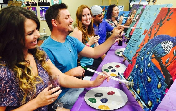 People participate in a painting event