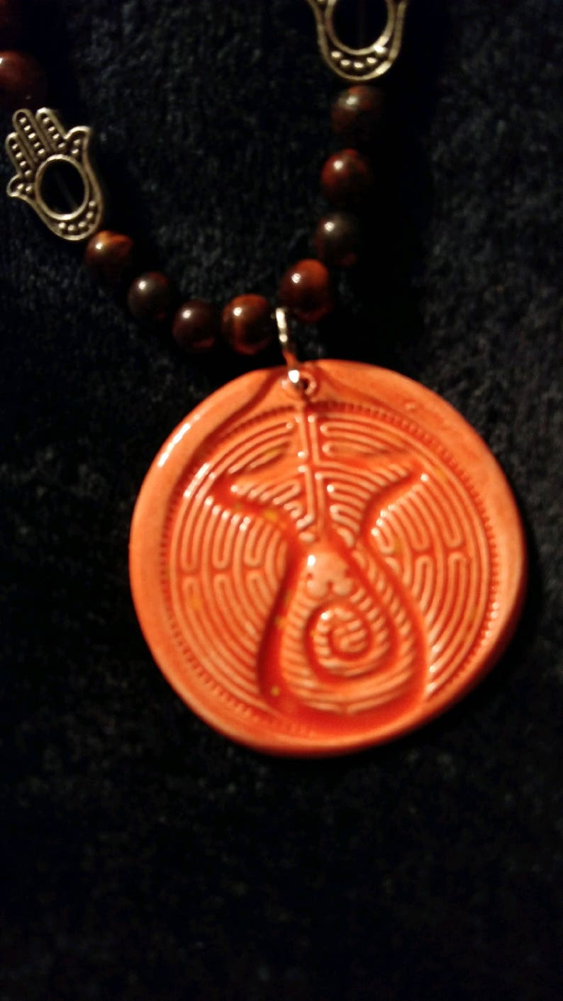 Ceramic Peace Goddess Labyrinth pendant with red tiger eye, hamsa, healing  hands