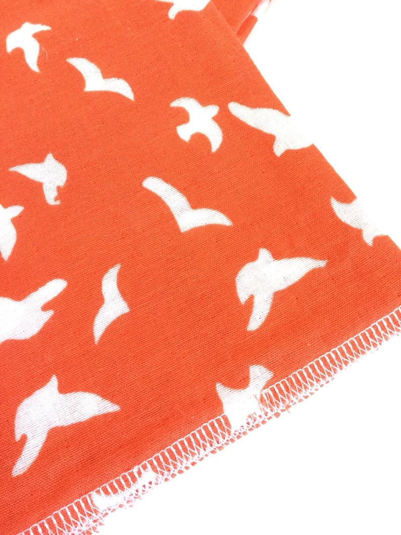 Gauze XL baby blanket in bright coral orange with white bird print...XL...infant swaddler