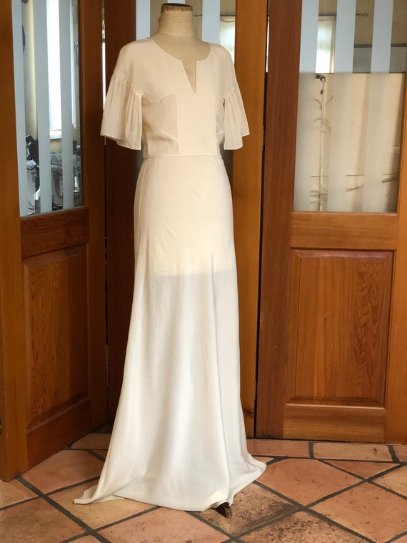 1930s silk crepe bride dress with pleated sleeves.