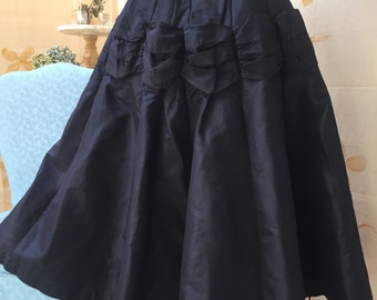 Extra full 1950s navy blue silk taffeta skirt with swag features at hip.