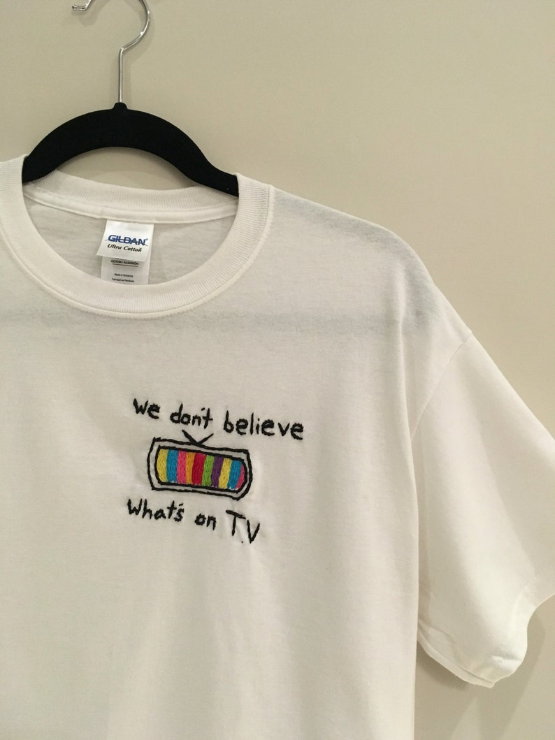 0371a30f0c1826 We Don t Believe Whats s on T.V Embroidered T-Shirt