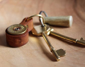 Cartridge key ring with leather strap