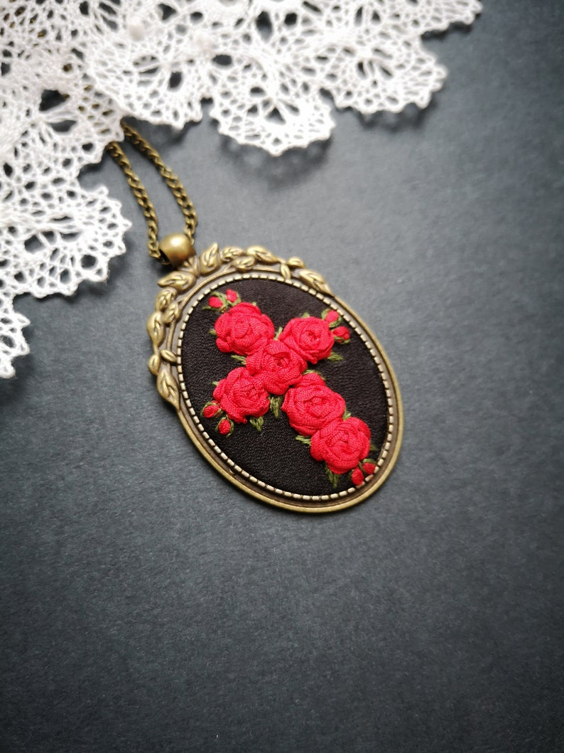 Red cross and black necklace image 0