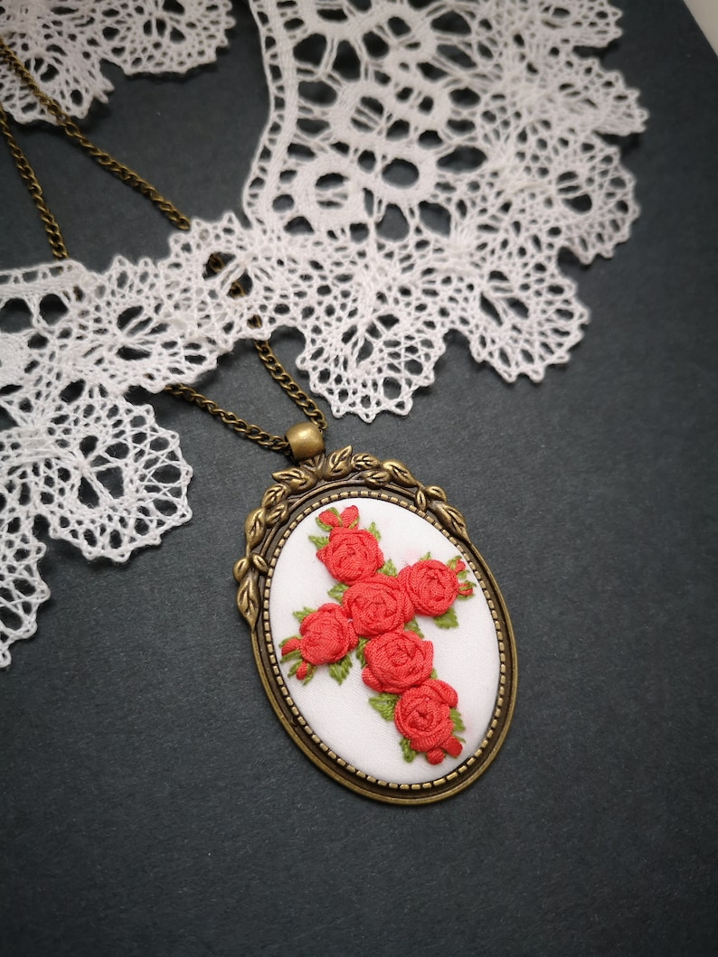 Red roses cross and white necklace image 0