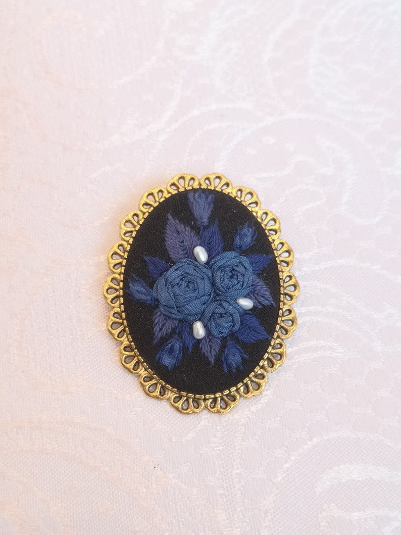 Sapphire rose mystery brooch 2 image 0