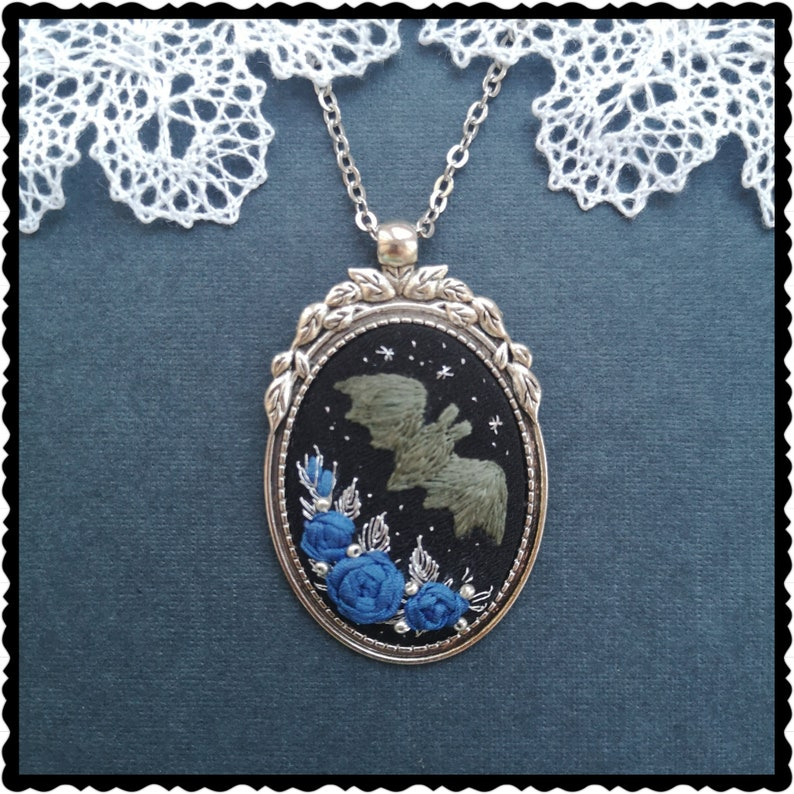 Baby bat and blue roses necklace image 0