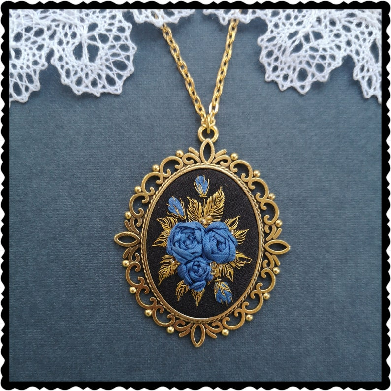 Blue roses and gold necklace image 0