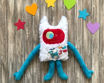 Hug Monster plush toy Monstre à Câlins with horns and a secrets or kisses pocket with cute dogs