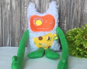 Hug Monster with horns/ears, handmade plush, green with pineapples  print pocket, baby shower or birthday gift for baby, plushie monster