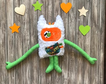 Cuddle Monster (Monstre à Calins) plush, green and orange with a monsters on the pocket, kids toy, day care helper, baby shower gift