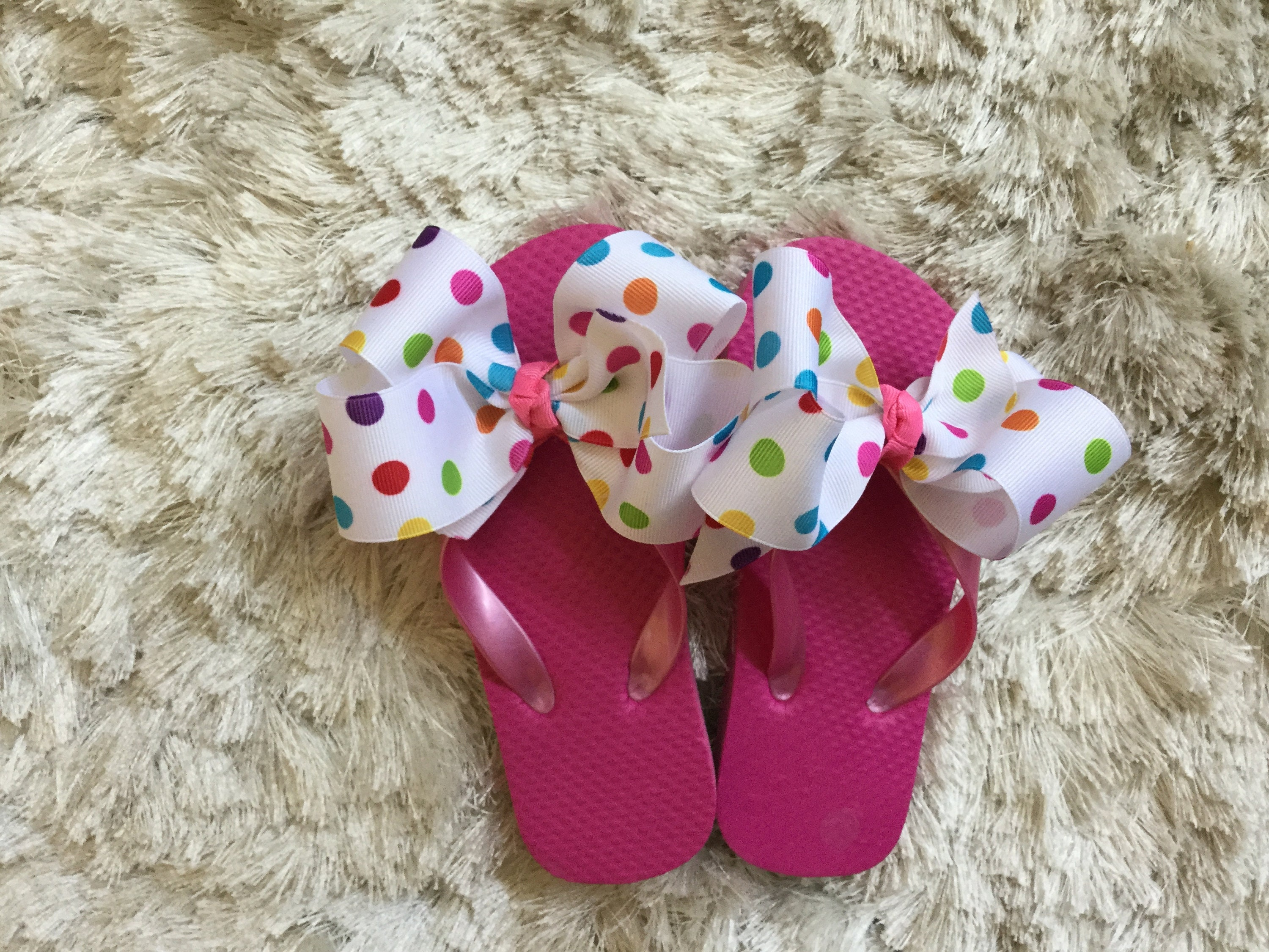 e8437eac2 Childrens Hot Pink   Multi Polka Dot Bow Flip Flops. gallery photo ...