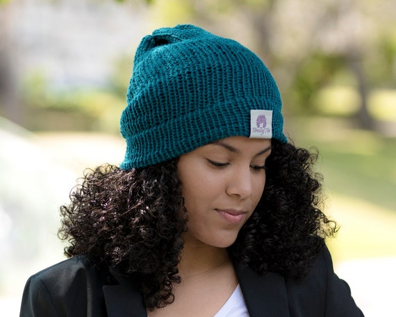Curly hair with a beanie