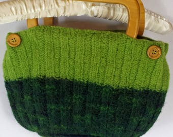 C109 medium sized knitted, felted green purse with wooden buttons and handles, lined
