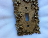 Mid century ornate hollywood regency gold toned floral switch plate