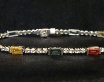 18 k white gold diamond and multicolor emerald cut genuine sapphires link bracelet,7 inches length