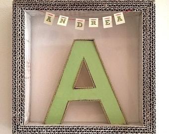 Initial cardboard and name