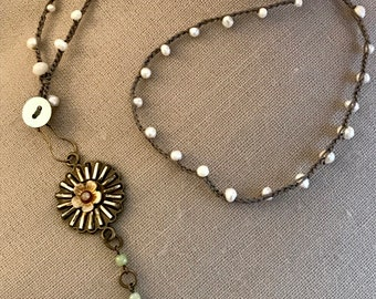 """32"""" Ivory freshwater pearl necklace with unique flower pendant with green accents"""