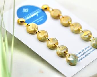 Golden Sea Glass: Pebble Dangles