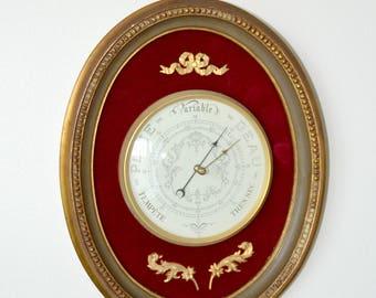 Classic barometer gold on red velvet, Louis XVI style.