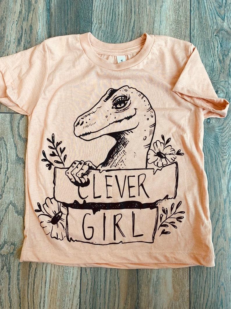 65497ac27 Dinosaur Clever Girl youth tee // prehistoric love // pretty   Etsy