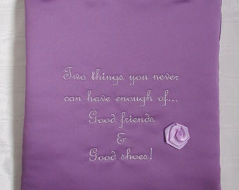 Shoe bag in mauve satin embroidered with 'good friends and good shoes' quote