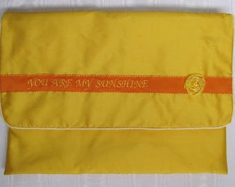 Nightdress case in yellow pure silk with embroidered You Are My Sunshine.