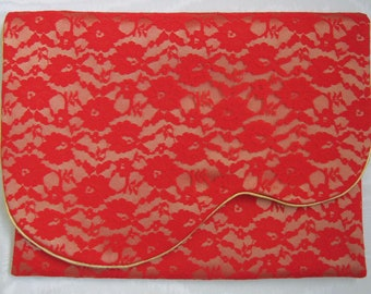 Nightdress case or lingerie case in gold satin overlaid with red lace.