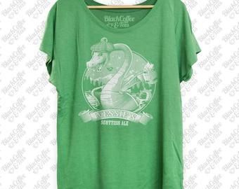 St. Patricks Day Shirt - Loch Ness Monster Shirt - Nessie The Loch Ness Monster Drinking Scottish Ale