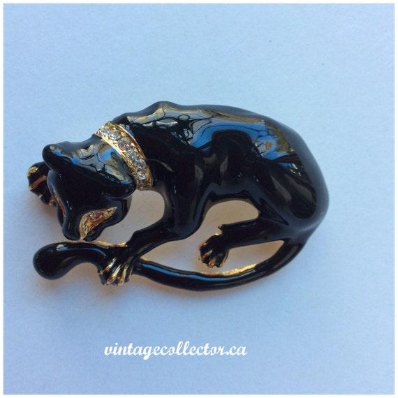 Vintage black enameled Jaguar rhinestone eyes and