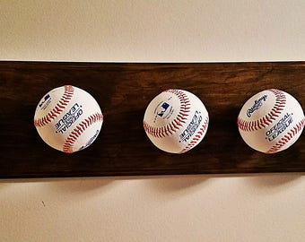 Wood hat rack made with baseballs