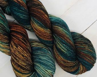 Poseidon - Hand dyed superwash merino & nylon sock yarn. 434 yards. 4oz/115 grams. Perfect for knitting, crochet, weaving or any fiber art.