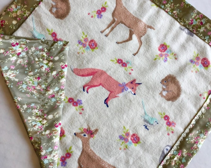 Lovey, baby blanket, crib blanket, silky blanket. Beautiful flannel front backed and edged with floral charmeuse silky. Baby gift