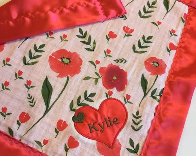 Double Gauze Red Poppies lovey, Red poppy muslin front, backed and edged with coordinating silky fabric, measures approx 20x20.