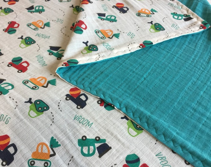 Double gauze swaddle, Muslin swaddle, baby blanket, Construction, trucks, swaddle blanket, backed with turquoise muslin.