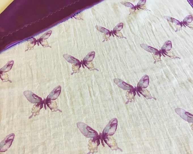 Gorgeous double gauze butterfly muslin, backed and edged with coordinating purple silky fabric. Approximately 30x40