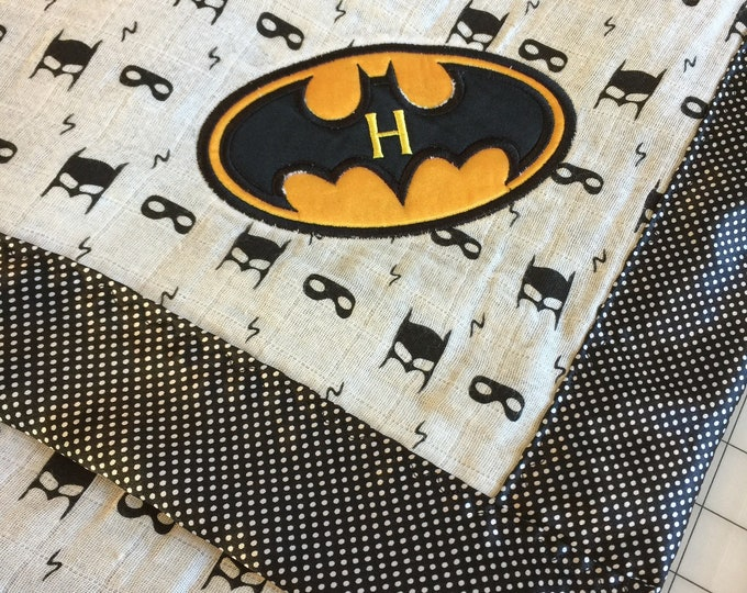 Adorable double gauze Batman muslin, backed and edged with coordinating pin dot silky fabric approx 44x44